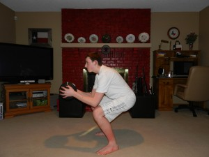 squat - touch elbows to knees - butt back!