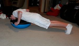 showing how to do a push-up on the BOSU