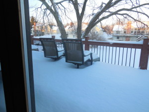 back deck - snow almost up to bottom of chairs