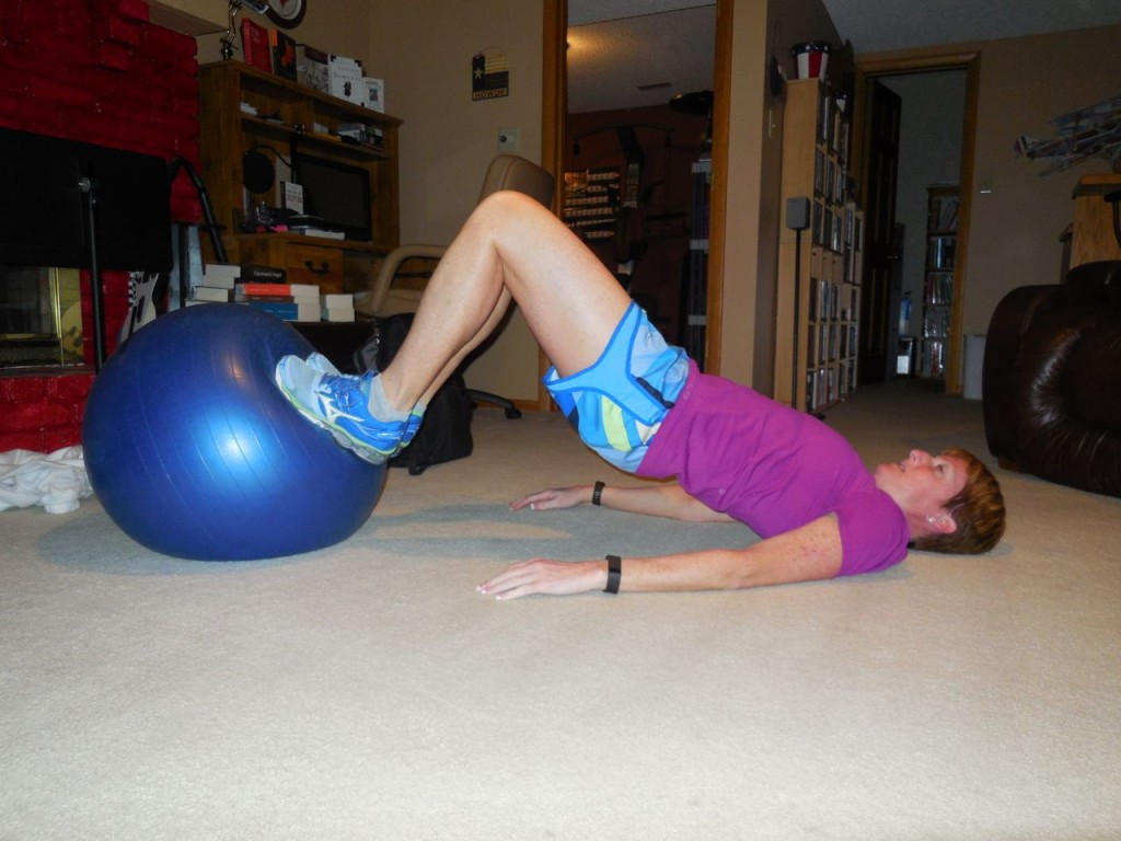 use your hamstrings to roll the ball toward you