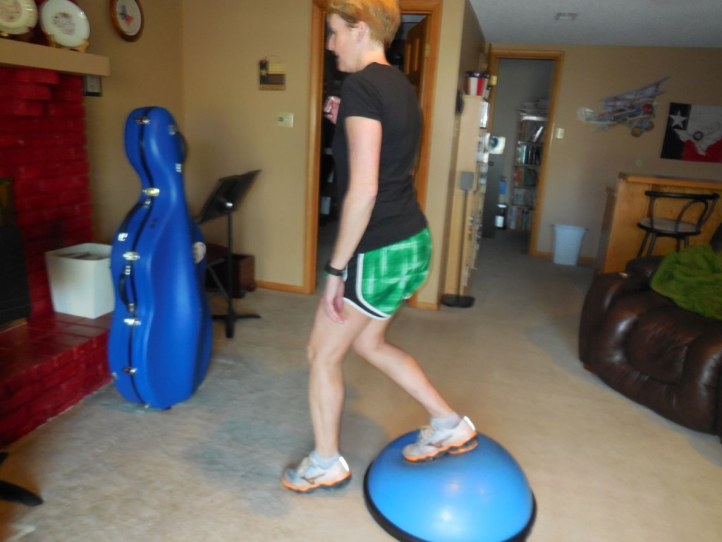stand on BOSU with right leg - left leg steps front